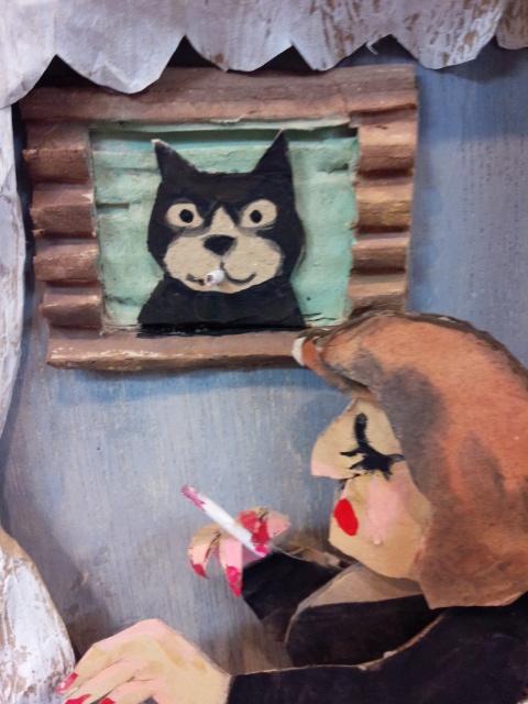 タバコ片手に、ため息をつくマダムを慰める、額の中のネコも、タバコくわえているんだよ~